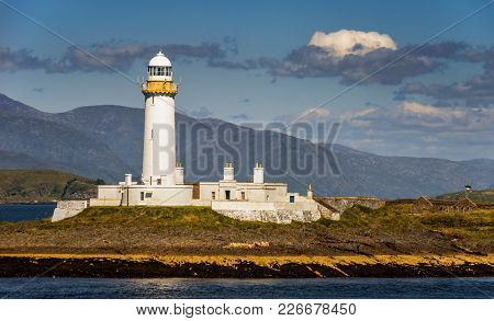 Lighthouse On Eilean Musdile Near Oban In Daylight, Scotland