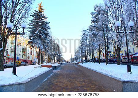Chernihiv / Ukraine. 24 January 2018: Beautiful Winter Park With Trees Lanterns And Path. 24 January
