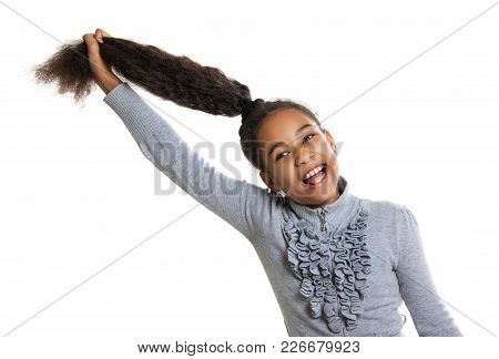 Funny Dark-skinned Girl Holding Her Hair. Positive Human Emotions. Laughter And Fun