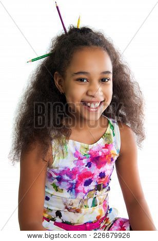 Portrait Of A Cute Black Girl On A White Background. Positive Human Emotions. The Child Smiles. Mult