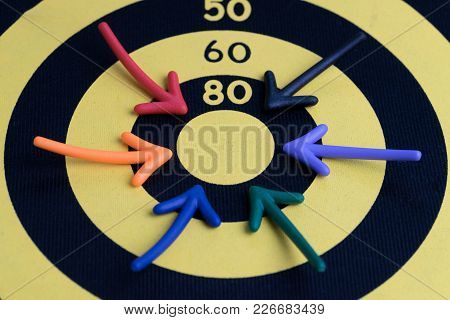 Business Success Target Concept, Multi Colorful Magnet Arrows Pointing At Center Score Of Yellow Wit