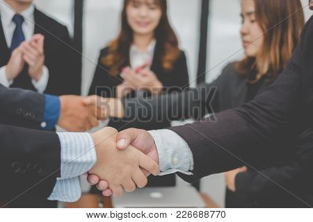 Business People Shaking Hands After Finishing Up Meeting. Co Worker Colleagues Handshaking After Con