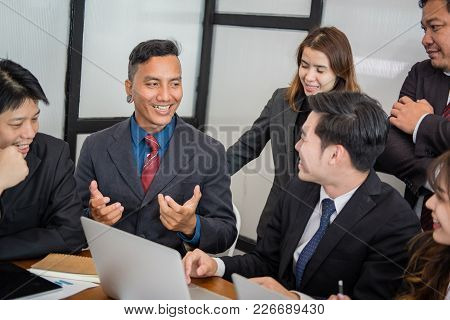 Business People Having A Meeting. Businessman & Businesswoman Working With Financial Chart Report. S