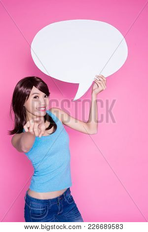 Woman Take Speech Bubble And Show Something On The Pink Background