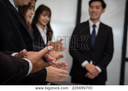 Cheerful Businessman Applauding At Conference. Successful Business Team Clapping Hands For Great Wor