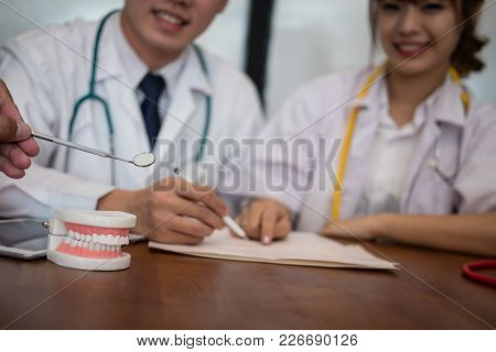Dentist Co Worker Discussing Patient Teeth Treatment With Jaw Teeth. Orthodontist Have Meeting For D