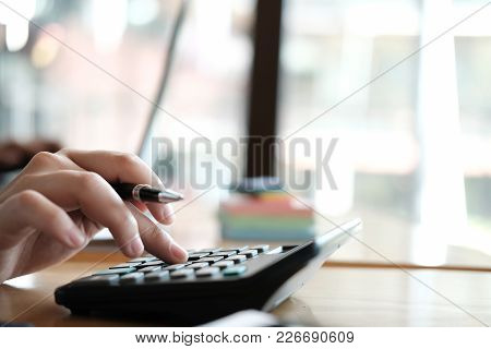 Financial Adviser Working With Calculator & Computer At Office. Accountant Doing Accounting & Calcul