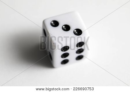 Dice Shot Up Close On A White Background, Three