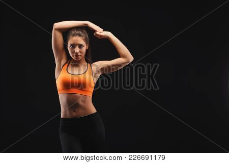 Athletic Woman, Bodybuilder. Muscular Body And Strong Muscles. Studio Shot On Black Background, Low