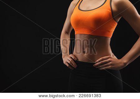 Unrecognizable Athletic Woman, Bodybuilder. Naked Torso, Muscular Body. Studio Shot On Black Backgro