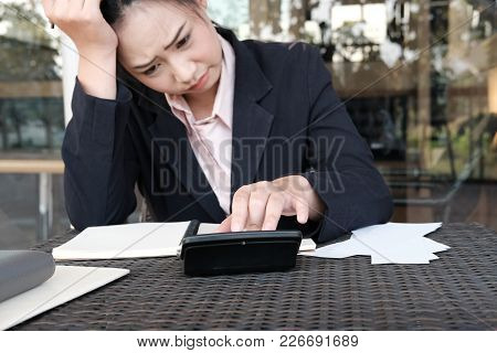 Woman Calculate Domestic Bills At Home. Businesswoman Using Calculator At Modern Office. Young Femal