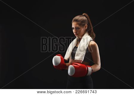 Gorgeous Young Woman With Boxing Gloves Having Rest After Fight. Mockup, Copy Space. Studio Shot On