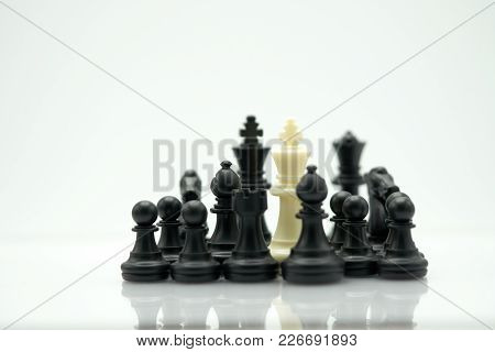 A Chess Piece On The Back Negotiating In Business. As Background Business Concept And Strategy Conce
