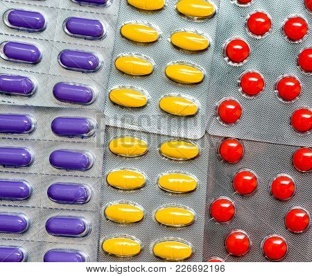 Pile Of Colorful Tablet Pills In Blister Packs. Global Healthcare Concept. Pain Killers Medicine Use