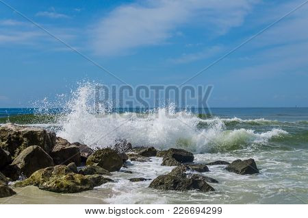 Ocean Beach Waves Crashing Onto Rocky Shoreline. Beautiful Display Of Natures Power And Beauty. Scen