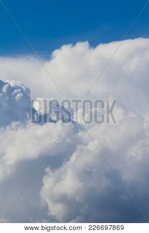 Peaceful, Summer sky with blue colors and very pure white clouds