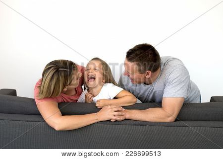 Young Beautiful And Happy Caucasian Couple With Mother And Father Playing Tickles On Cheerful Adorab