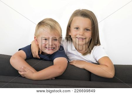7 Years Old Beautiful Little Girl Posing Happy Playing At Home Sofa Couch With Her Small Cute Young
