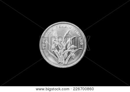 A Macro Image Of A Chinese One Jiao Coin Isolated On A Black Background