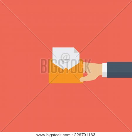 Email And Incoming Messages Concept. Mail Delivery Service. People Hand Holding Yellow Envelope In F