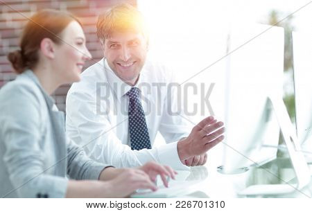 Manager and assistant work with a PC