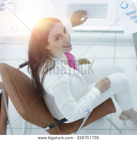 view from the top. photo of a female accountant
