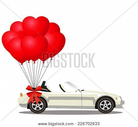 White  Modern Opened Cartoon Cabriolet Car With Bunch Of Red Helium Heart Shaped Balloons With Festi
