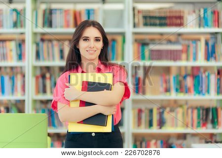 Academic Girl Holding Her Book And Papers In A Library