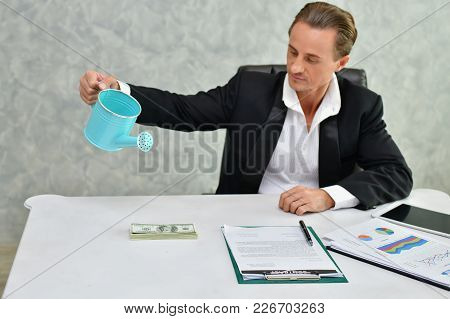 Concept Very Wealthy Businessman. Businessman Is Happy With His Money.a Businessman Showing His Mone