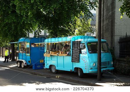 LONDON-ENGLAND, JUNE 10, 2017: Food trucks ready to serves meals in the street.  London's street food dates back centuries and are a part of the londoners culture.