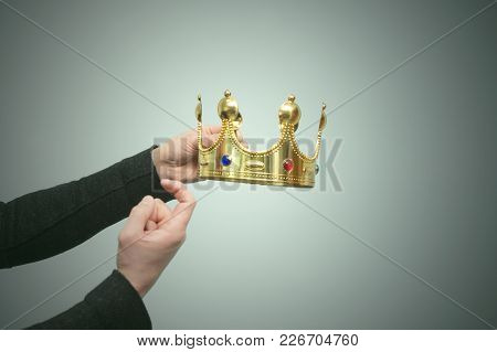 The Man Hand Holds The Gold Crown As A Symbol Of Power And Beckons Someone To Himself For Its Transf