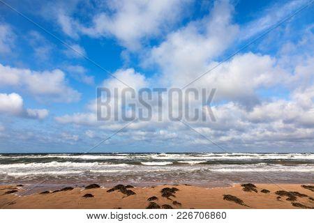 Rough seas and big sky at Thunder Cove  Beach, Price Edward Island, Canada.