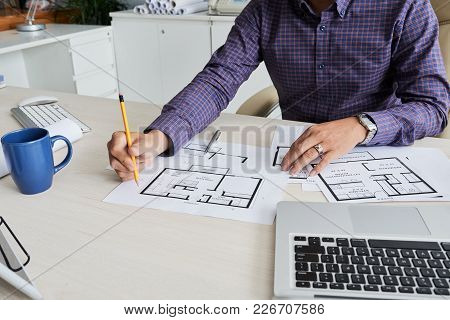 Close-up Image Of Architect Checking Blueprint Project