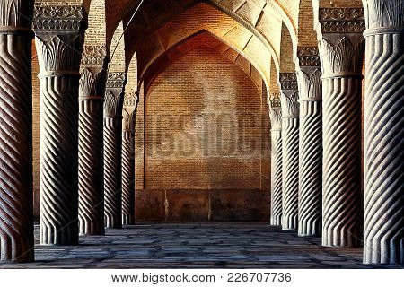 Iran, Shiraz, Vakil Mosque - September 17, 2016: Ancient Columns Of The Vakil Mosque In Shiraz. Anci