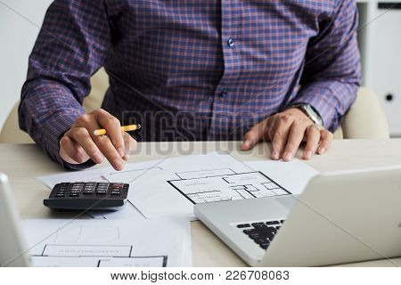Close-up Image Of Architect Caculating Estimated Construction Cost
