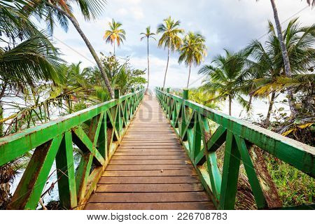 Wooden boardwalk on the tropical beach in Costa Rica, Central America