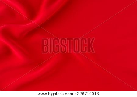 Deep Red Silk Smooth Wavy Background With Copy Space.