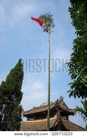 Neu Tree. Vietnamese People Have A Custom Of Erecting A Bamboo Pole, Known As A Neu Tree, In Front O