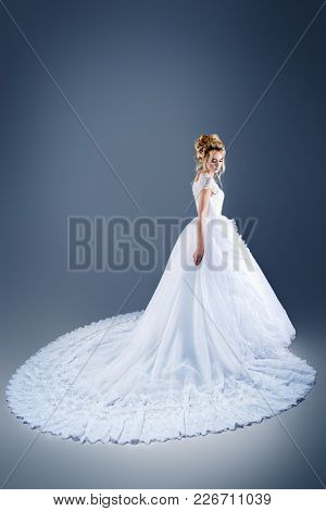 Portrait of a beautiful tender bride woman wearing luxurious white wedding  dress. Wedding. Beauty, fashion concept.