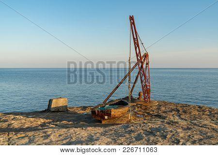 A Fishing Boat And A Crane Near Portland Bill Lighthouse, Jurassic Coast, Dorset, Uk