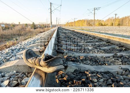 Close-up Of Shoes On The Tracks In The Accident On Railway Road, The Remaining Shoes, Fall Outside T