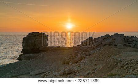 Sunset At Pulpit Rock, Near Portland Bill Lighthouse, Isle Of Portland, Jurassic Coast, Dorset, Uk