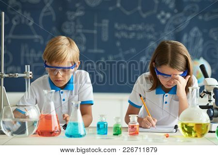 Children Wearing Goggles At Chemistry Lesson In School