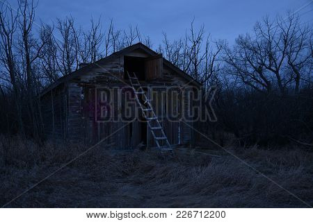 Abandoned Barn With Ladder In Early Morning