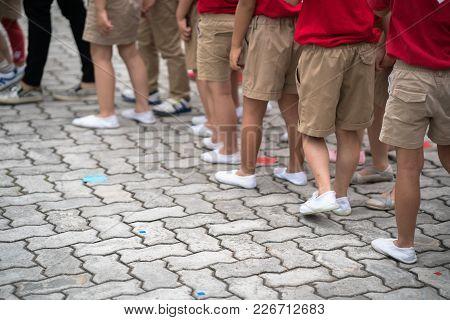 Uniformed Children Aligned Legs Standing On School Playground
