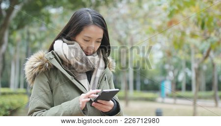 Woman use of mobile phone at park