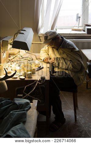Uelen, Chukotski Region, Russia - Settlement Uelen, June 28, 2017: The Carver On A Bone, Works In Th