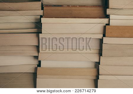 Stack Of Books Background. Row Of Books As Background For Design. Education And Wisdom Concept. Old