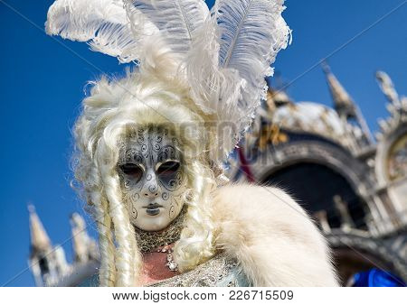 Venice, Italy - February 11: Woman In White Costume At Traditional Carnival On February 11, 2018 In