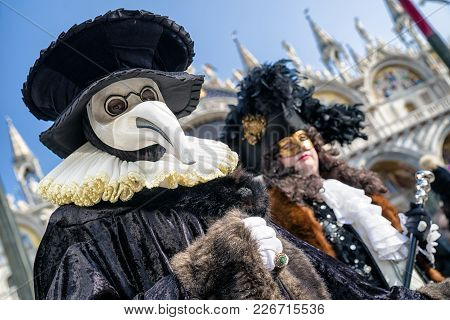 Venice, Italy - February 11: People In Colorful Costumes At Traditional Carnival On February 11, 201